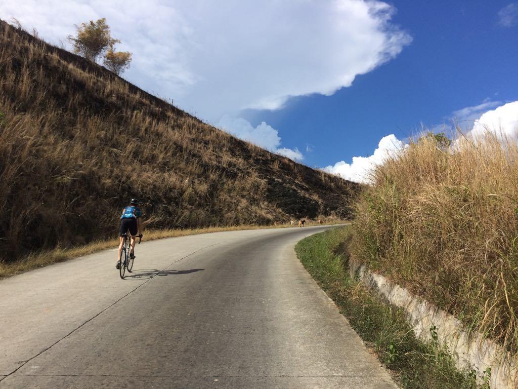 Cycling Matters presenter Hidde van der Wall climbing the wall on his steel bike, Kalabaw