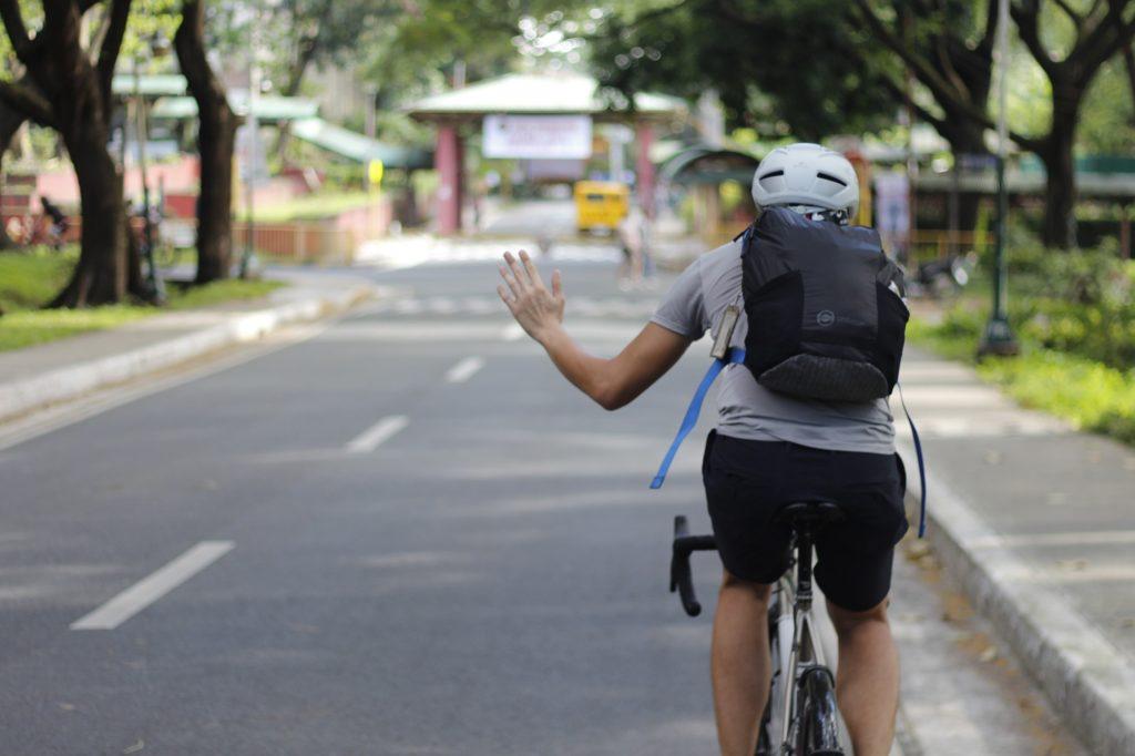 Go ahead cycling hand signal
