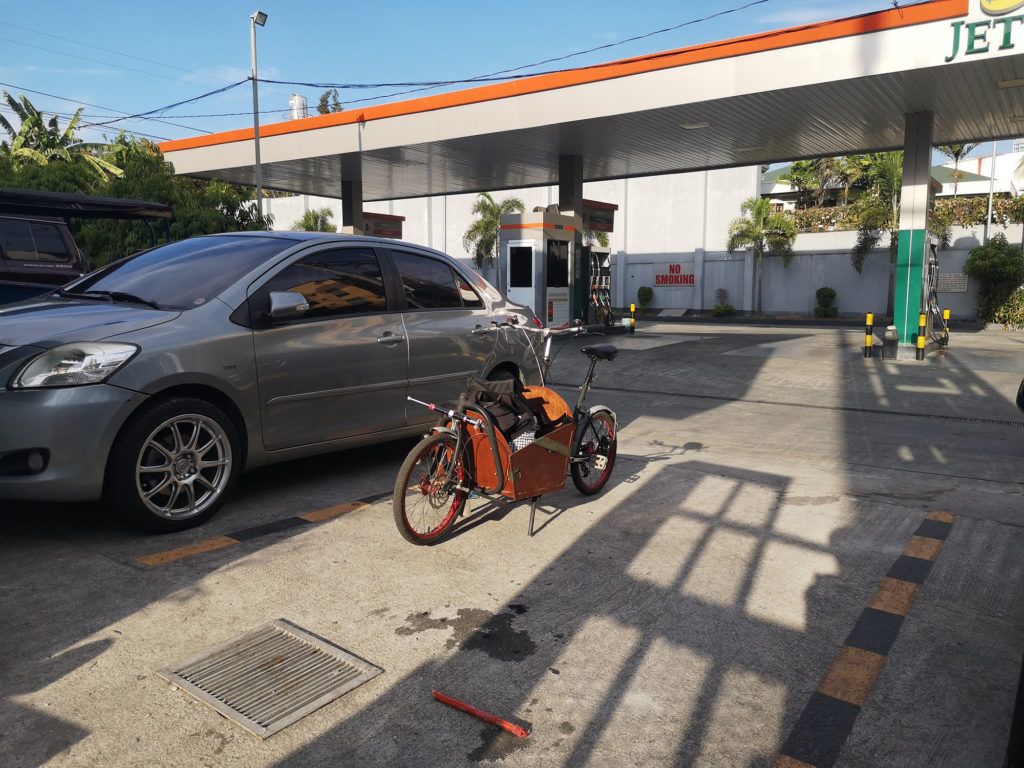 Compact Utility Bike (CUB) parked beside a car