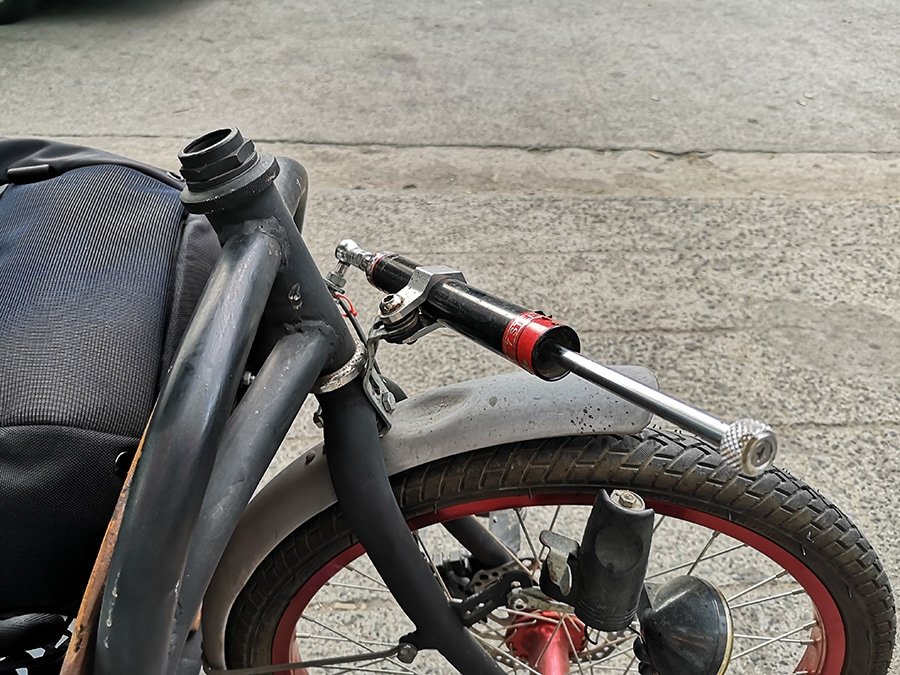 Compact Utility Bike (CUB) hydraulic steerer tube damper