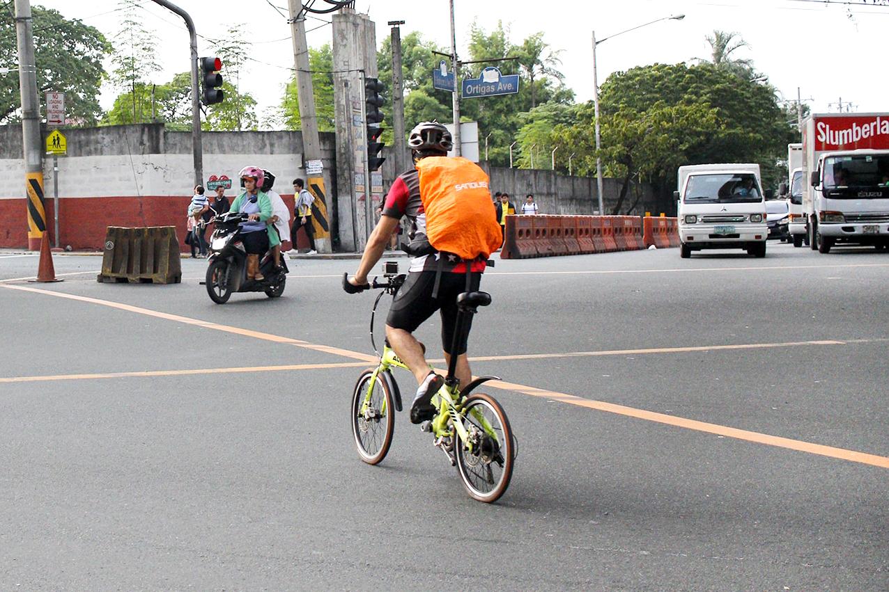 Bike commuter on a folding bike